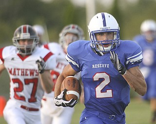 ROBERT  K.  YOSAY  | THE VINDICATOR --..#2  Donnie Bolton for Western Reserve takes the ball 85 yards in his first of two touchdowns  in the first quarter. the last man he beat was mathews #27  Ryan Mazey---Western Reserve Blue Devils  vs Mathews Mustangs at  Western Reserve Stadium Thursday night .--30-..(AP Photo/The Vindicator, Robert K. Yosay)