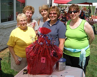 """The League of Women Voters of Trumbull County sponsored a basket raffle at Cortland's """"Summer Sizzle"""" Aug. 5 to raise money to print its """"Voter Information Guide."""" The guide identifies candidates, upcoming ballot issues and candidates' views on those issues. Winner of the basket was Marjorie Haidet of Youngstown. Shown above, with the basket, are, from left, Nancy Lorey, league director; Eddie Wolcott, event chairwoman and director; Peggy Boyd, director; Terri Crabbs, past president; and Janice Hardman, president. The league is still accepting donations for the guide. Donations are tax-deductible."""