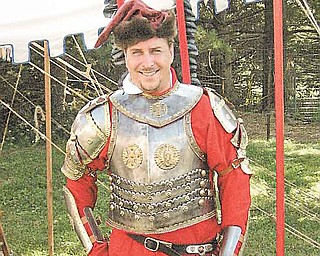 Mike Ostrowski is a re-enactor who dresses as a Hussar, a Polish cavalry soldier of the 16th century. He will be on hand at the Polish Day festival Sunday at St. Anne Church in Austintown..