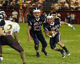 Niles defensive back #11 L.J. Cox looks for a block from teammate #51Brett Spencer after making an interception.
