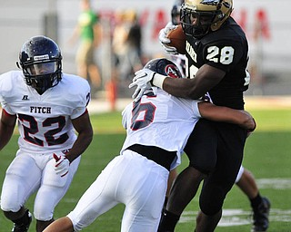 Warren Harding running back #28 LeShun Daniels is tackled by Fitch saftey #6 Lucas Haupt.
