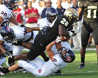 Fitch saftey #6 Lucas Haupt strips Warren Harding running back #28 LeShun Daniels of the ball.