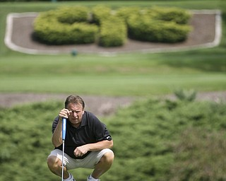 JESSICA M. KANALAS | THE VINDICATOR..Jim Slivanya putts during day two of the Greatest Golfer Tournament at Youngstown Country Club... -30-