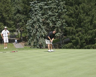 JESSICA M. KANALAS | THE VINDICATOR..Greg Cook putts during day two of the Greatest Golfer Tournament at Youngstown Country Club... -30-