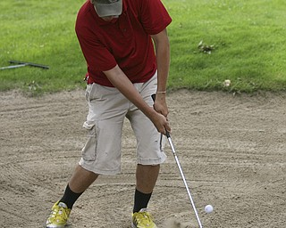 JESSICA M. KANALAS | THE VINDICATOR..Greg Cook chips his ball out of a sand pit during day two of the Greatest Golfer Tournament at Youngstown Country Club... -30-