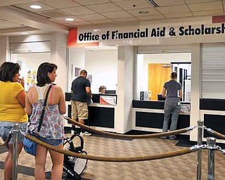 Wendy Kosovec, left, of McDonald, and her daughter, Cassandra, wait Friday afternoon at YSU's Office of Financial Aid and Scholarships. Cassandra, who will be a freshman studying early childhood education, came to check on the status of her financial aid.