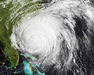 This satellite image provided by NOAA and taken at 12:45 GMT Friday Aug. 26, 2011 shows Hurricane Irene as it moves northward along the U.S. eastern coastline with 110 mph sustained winds. Hurricane Irene began lashing the East Coast with rain Friday ahead of a weekend of violent weather that was almost certain to heap punishment on a vast stretch of shoreline from the Carolinas to Massachusetts. (AP Photo/NOAA)