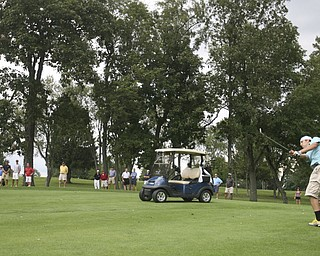 JESSICA M. KANALAS | THE VINDICATOR..Bystanders watch Greg Cook of Mahoning Country Club hit during the final day at the Greatest Golfer of the Valley tournament at The Lake Club.