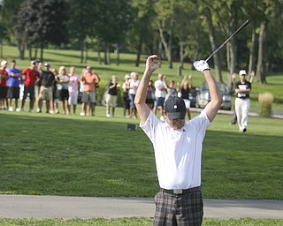 JESSICA M. KANALAS | THE VINDICATOR..Scott Porter of Tippecanoe Country Club shows his excitement, and the crowd in the background joins him, after successfully chipping his ball into the last hole of the final day at the Greatest Golfer of the Valley tournament at The Lake Club.