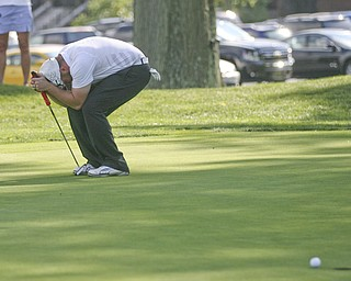 JESSICA M. KANALAS | THE VINDICATOR..Josh Zarlenga of Youngstown Country Club bends down in disappointment after barely missing his putt on the next-to-last hole during the final day at the Greatest Golfer of the Valley tournament at The Lake Club. The miss was a potential winner as he ended the day tied for the lead and lost in a one-hole playoff.