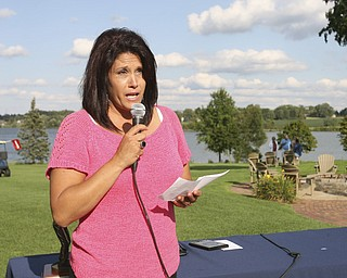 JESSICA M. KANALAS | THE VINDICATOR..Mary Beidelschies, daughter of the late Vindicator sports writer Pete Mollica, speaks during the award ceremony for the Greatest Golfer of the Valley tournament at The Lake Club.