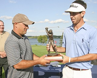 JESSICA M. KANALAS | THE VINDICATOR...Pete Mollica Jr., son of the late Vindicator sports writer Pete Mollica hands the winning trophy to Anthony Conn of Mill Creek Golf Course, giving Conn the 2011 Greatest Golfer of the Valley Champion title... -30-