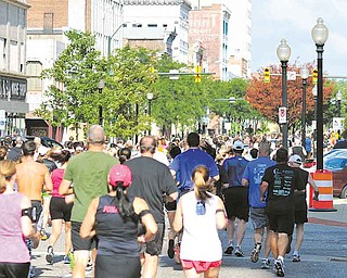 Thousands of Panerathon runners dash down West Federal Street in Youngstown. The fundraiser drew 4,000 participants Sunday.