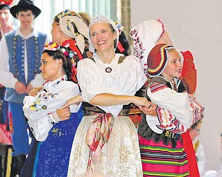 Cathy Pilat Katvenich, center, Chantel Bahm, left, and D'ella Heschmeyer, right, of the Krakowiaki Polish Folk Circle dance Sunday afternoon during the annual Polish Heritage Day festival at St. Anne's Church in Austintown.