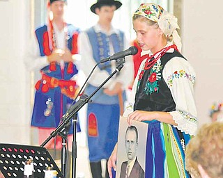 Lexxi Halushka of Austintown tells an audience at the Polish festival about her great-grandfather. Sunday's festival also featured two polka bands, polka demonstrations, folk-art vendors and Polish language and genealogy classes.