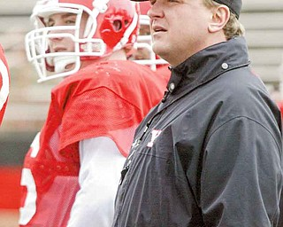 After getting cut by the Phoenix Cardinals in 1994, Eric Wolford, right, started his coaching career at his alma mater, Kansas State. Fifteen years later, he was hired as the head coach of Youngstown State.
