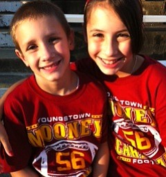 Vincent and Madelyn Ballone at Mooney vs McKinley Game cheering on their older brother Bobby #56 for Mooney!