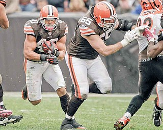 Cleveland Browns running back Peyton Hillis (40) follows a block by guard Eric Steinbach (65) against the Cincinnati Bengals in their NFL football game on Sunday, Oct. 3, 2010, in Cleveland.  (AP Photo/Amy Sancetta)