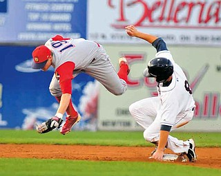 Scrappers base runner #8 Todd Hankins slides in safly to second while Crosscutters second basemen leaps to field the ball.