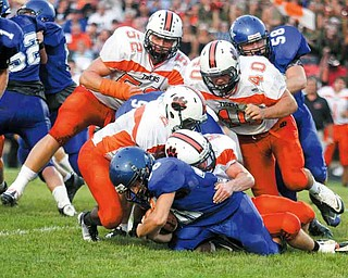FOOTBALL - The Howland defense (9) Robby Klose (2) Tony Osborne (40) Brandon Miller and (52) Dan Moody stop (30) Ryan Scott for no gain during thier game Thursday night in Cortland. - Special to The Vindicator/Nick Mays