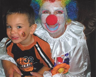 "Beth Schutz, ""Memaw"" (grandmother) to Scottie Eaton, dressed up as a clown for Scottie's 4th birthday on Aug. 16, 2010. Both live in Canfield."