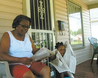 Donna Clayton of Youngstown reads the newspaper to her granddaughter, Saria Drake of Youngstown. Donna's daughter, Darlene Drake of Youngstown, who submitted the photo, says, her very patient mom takes care of the energetic, inquisitive and humorous Saria, who is 3 years and 7 months old.