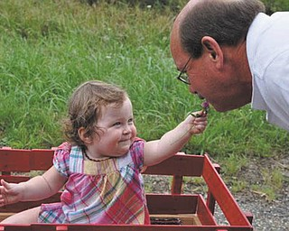 Naomi Lane of Wahalding, Ohio, has Grandpa Dave Dickey of North Lima stopping to smell the flowers!