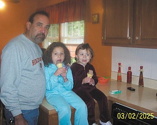 Aubin Rivera of Canfield poses with his two granddaughters, Bella and Olivia of Pennsylvania.