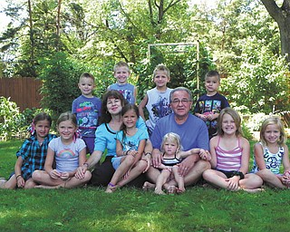 Steve and Beverly Mirich (the parents of two) are the proud grandparents of 10, ages 3 through 10. Five live in town and five live in North Carolina. Each year they gather to visit; this is a picture from this year's get-together: In front, Mealee, 7; Faith, 8; Bubba, as the kids call her, holding Sami, 6; PapPap, as the kids call him, holding the youngest, Tori 3; Abbey, 10; and Isabella, 8. The boys, in back, are Deacon, 4; Joshua, 7; Brady, 5; and Isaac, 4. Each family has 2 boys and 3 girls. Tammy Loew, the Miriches' daughter, submitted the photo.