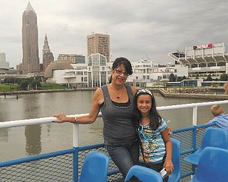 Mama Candida Godoy poses with her granddaughter, Aliya Abeid, on the Goodtime 3 in Cleveland.