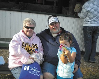 Bob and Sheree Savon of Youngstown are with their grandaughter, Mikayla Upright, at the Canfield Fair.