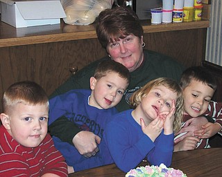 Nana Dedo is holding four of her six grandchlidren, Quinton, Ross, Sophia and Alan.