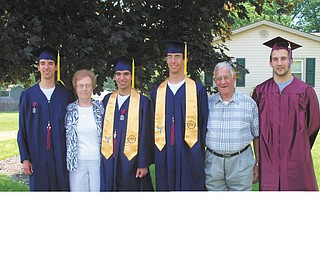 Bev and John Mashiska are pictured with their triplet grandsons, Michael (left), Scott and Jake Miller, who graduated from Austintown Fitch, and another grandson, Eric Yovanovich (right), who graduated from Boardman High School. All four graduated this June. The family says they are the most supportive grandparents ever, attending every football game, track meet, band concert and baseball game that their grandsons participated in. Their family includes another grandson, Dominic Mashiska, an 8th-grader at IHM St. Joseph School, not pictured.