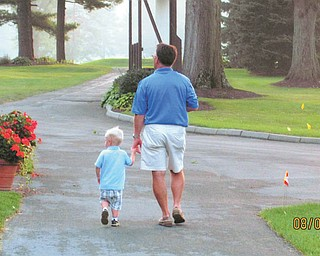 Patrick Riley III of Akron goes for a walk with his grandpa, Dr. John Babyak of Canfield.