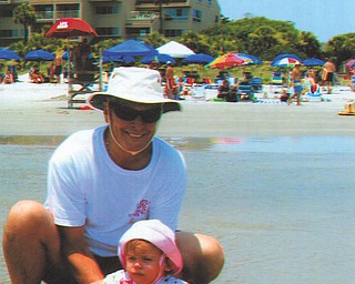 Bill Ogden is pictured with his first grandchild, Carrah, during a visit for the first time to Hilton Head in July.
