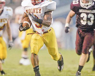 Cardinal Mooney's Roosevelt Griffin (3) sprints away from Boardman defender Ryan Ebie (33) during Friday's game in Boardman. The Cardinals got their second win of the season, edging the Spartans, 27-20.