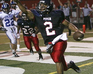 ROBERT  K.  YOSAY  | THE VINDICATOR --..Pointing to the crowd Fitchs #2 Demitrous Davis points out the 6 points as he runs into the endzone  during second quarter action -..Poland Bulldogs at Fitch Falcons Friday Night Game.--30-..(AP Photo/The Vindicator, Robert K. Yosay)