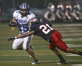 ROBERT  K.  YOSAY  | THE VINDICATOR --..Second quarter action as Polands #25  Mike Turnbull pushes  away #21 Will Harrington from Fitch --.Poland Bulldogs at Fitch Falcons Friday Night Game.--30-..(AP Photo/The Vindicator, Robert K. Yosay)