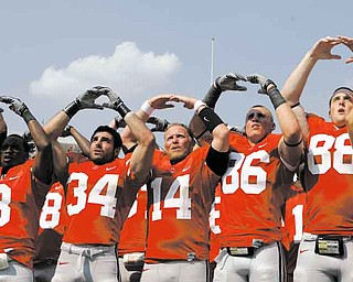 "Ohio State players sing ""Carmen Ohio"" after their 42-0 win over Akron in an NCAA college football game Saturday, Sept. 3, 2011, in Columbus, Ohio. (AP Photo/Jay LaPrete)"