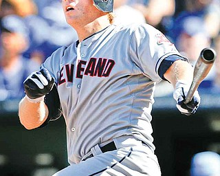 Cleveland Indians' Shelley Duncan hits a two-run home run during the eighth inning of a baseball game against the Kansas City Royals in Kansas City, Mo., Sunday, Sept. 4, 2011. It was Duncan's second homer of the game. (AP Photo/Orlin Wagner)
