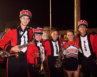 Band members Matt Wansack, Kayla Bornemisza, Ashley Hudzik, and Anthony Buzzacco, and cheerleader Sam Lawless celebrate Springfield's victory over Youngstown Christian
