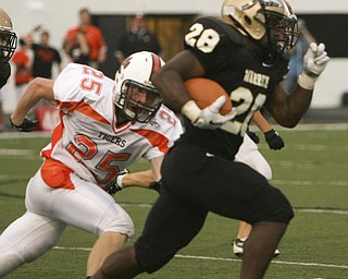 ROBERT  K.  YOSAY  | THE VINDICATOR --..Foot Race as Warrens #28 ( NO NAME)  takes off after a kick  as #25 Howland  Anthony Yassal eyes him to the sidelines .. - Howland Tigers vs Warren G Harding Raiders @ Warren ..--30-..(AP Photo/The Vindicator, Robert K. Yosay)