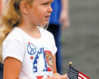 Stadium Drive third-grader Savannah White listened to the Boardman High School marching band as it played a medley of patriotic songs Friday.