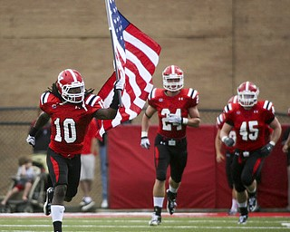 ROBERT K. YOSAY | THE VINDICATOR..YSU #10 Josh Lee carried the US FLAG onto the field as the quins  came onto the field  behind him is #24 Scott Senter.-30