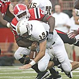 ROBERT K. YOSAY | THE VINDICATOR..YSU #52 Aronde Stanton crushes Valpos QB Eric Hoffman causing Hoffman to cough up the ball but he also recovered the fumble during second quarter action.-30