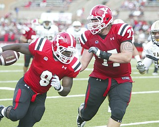 ROBERT K. YOSAY | THE VINDICATOR..YSU #9 Adaris Bellamy  breaks for a TD cruising 13 yards  in second quarter action as #77 D.J. Main protects him- as Valpo # 37 Mike Pando can only look on-.-30