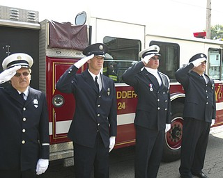 ROBERT  K.  YOSAY  | THE VINDICATOR --..Youngstown Fire Fighters salute as taps were played  l-r   Captain Ed Fay, Jeff Kaschak, Lt Be Szamara  and Carl Farina -..Solemn Service as St Patricks Church in Youngstown, commemerated 9-11 with a prayer, pledge of allegiance, a moment of silence and a flag to Bazetta fire dept by Rep Tim Ryan - the beam from the WTC was then touched by parioshners in a quiet solemn moment..--30-..(AP Photo/The Vindicator, Robert K. Yosay)