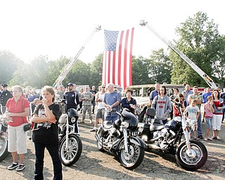 William D. Lewis | The Vindicator A large American Flag was displayed during a Sunday observance of the 9/11 attacks at the Austintown 9/11 Memorial Park. Hundreds of area residents and representatives from many fire departments were on hand for the event.