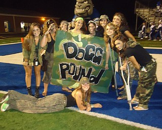 Some of the Poland Highschool Dog Pound gear up for their battle against Marlington.