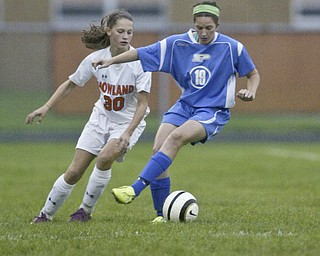 William D. Lewis  The Vindicator  Poland'sJeana Visingardi moves the ball past Howland's Alissa Grimaldi during 9-14-11 game at Howland.